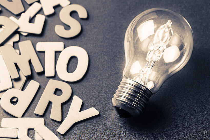 """Lightbulb with letters that spell """"Story"""""""