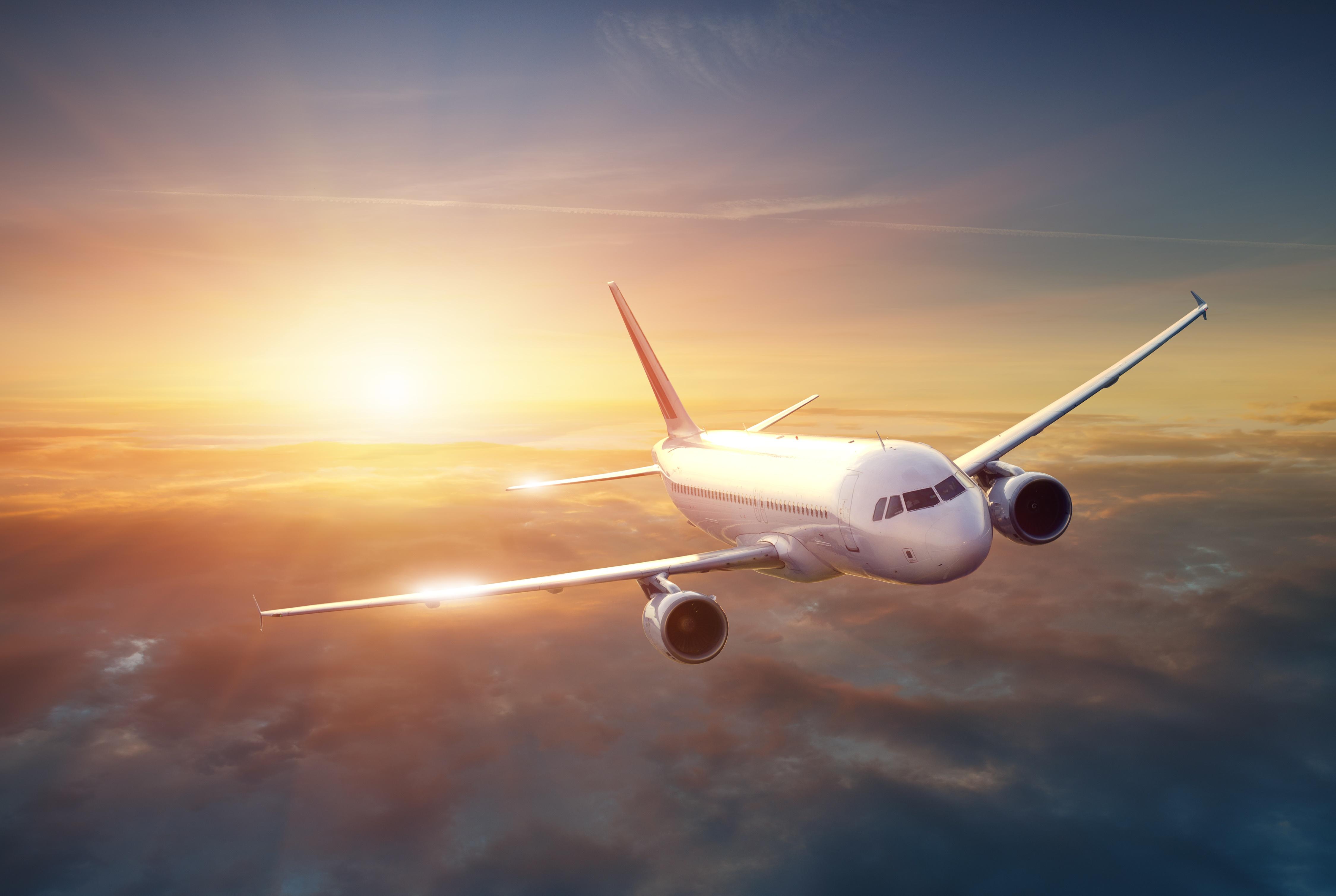 Airplane flying through skies.