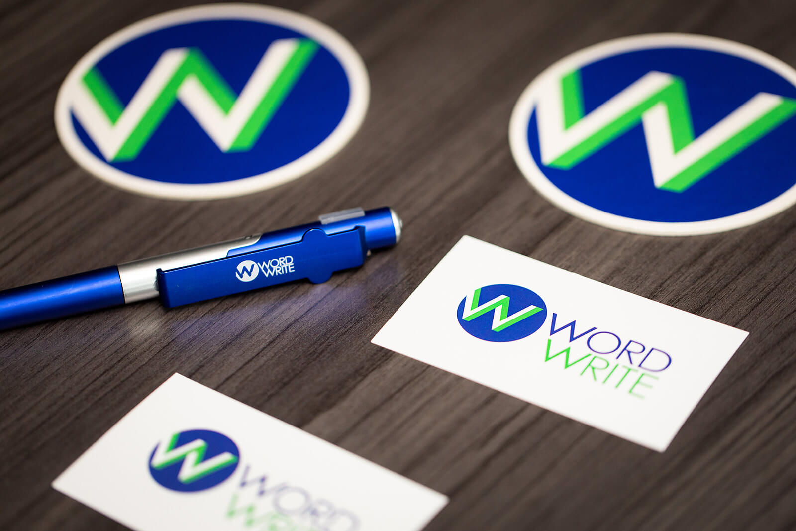 WordWrite coasters, pen, and business cards